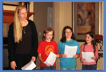 Home school mother and 3 kids reading poetry out loud